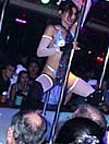 A Go Go Dancer at the Peak of the Show